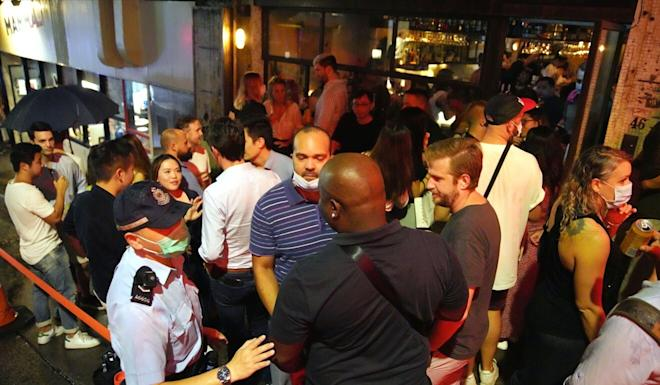 Police carry out checks at bars in Central after they resumed operation on Friday. Photo: Winson Wong