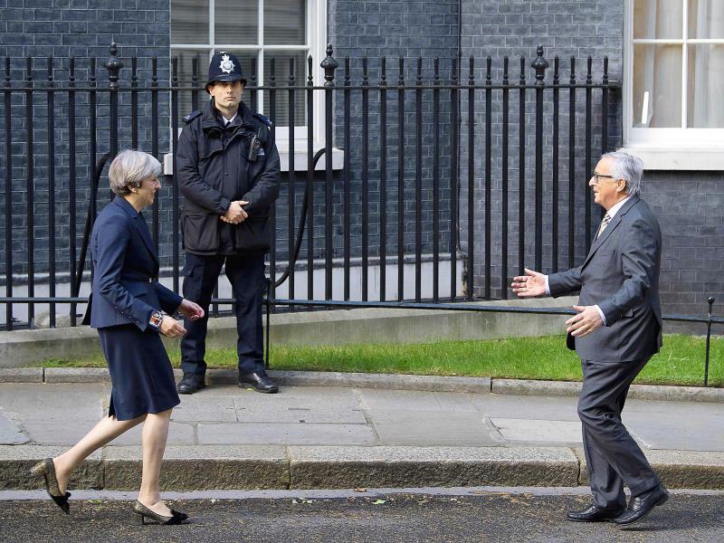 European Commission President, Jean-Claude Juncker is greeted by British Prime Minister Theresa May outside 10 Downing Street: Getty Images