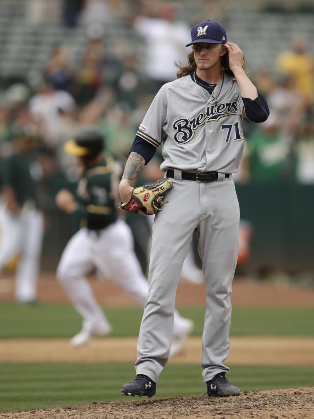 Milwaukee Brewers' Josh Hader (71) waits for the bases to clear after giving up a two-run home run to Oakland Athletics' Matt Chapman during the eighth inning of a baseball game Thursday, Aug. 1, 2019, in Oakland, Calif. (AP Photo/Ben Margot)