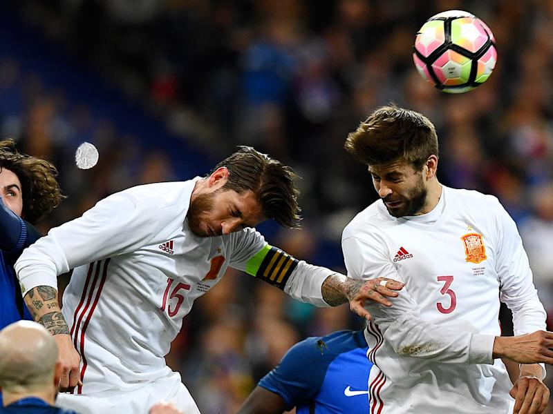Sergio Ramos and Gerard Pique lined up alongside each other in white for Spain: Getty
