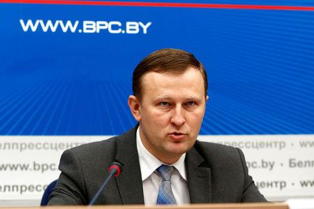 Belarus' KGB state security service spokesman Pobyarzhin speaks during a briefing in Minsk