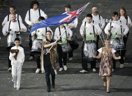 New Zealand's flag bearer Nick Willis holds the national flag as he leads the contingent in the athletes parade during the opening ceremony of the London 2012 Olympic Games at the Olympic Stadium July 27, 2012. REUTERS/Max Rossi