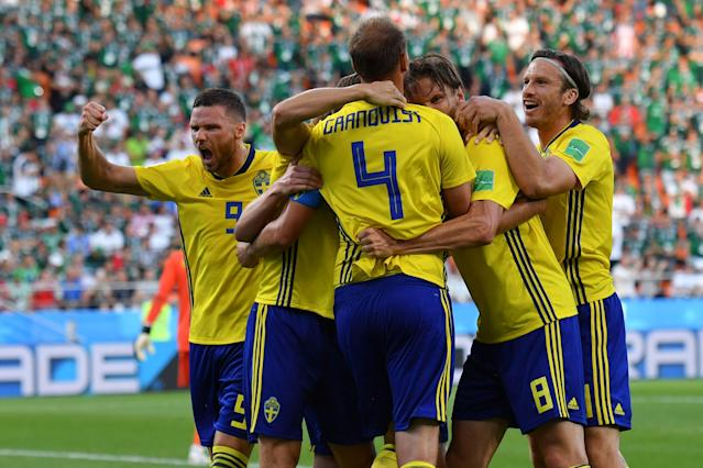 Sweden's defender Andreas Granqvist (4) celebrates with teammates after scoring a penalty during the Russia 2018 World Cup Group F football match between Mexico and Sweden at the Ekaterinburg Arena in Ekaterinburg on June 27, 2018. (Getty Images)