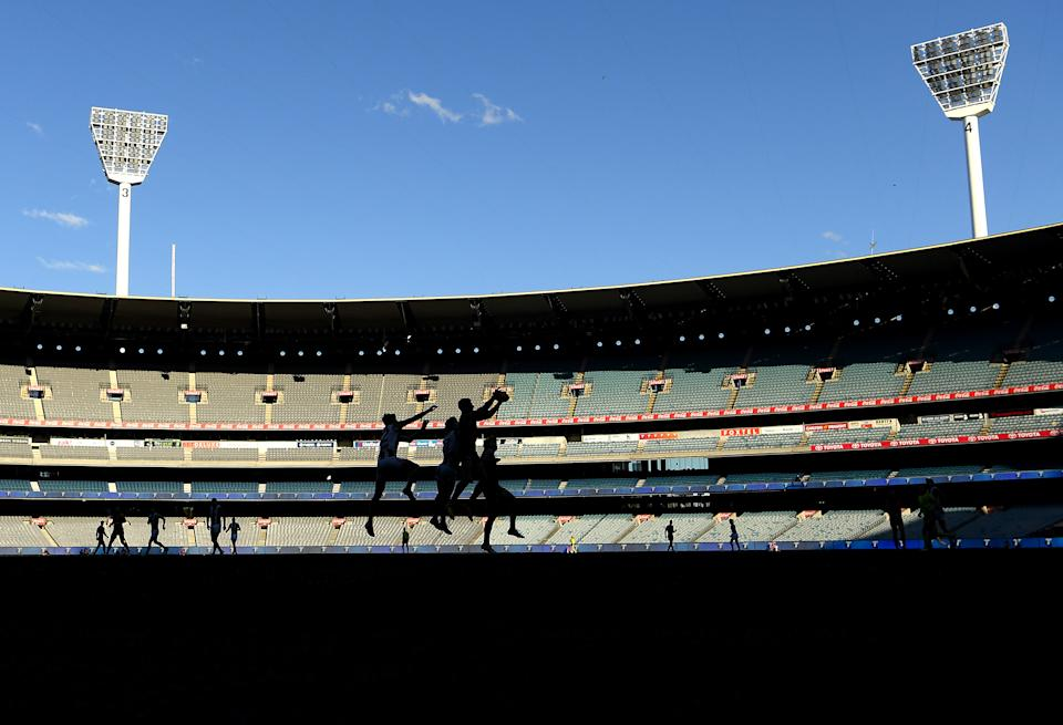 Players compete for a mark during the round 23 AFL match between Essendon Bombers and Collingwood Magpies Giants at Melbourne Cricket Ground on August 22, 2021 in Melbourne, Australia