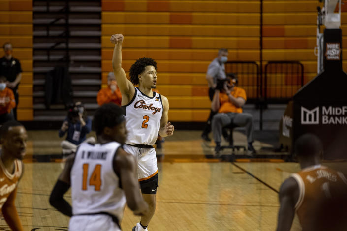 Oklahoma State guard Cade Cunningham (2) celebrates after making a basket in the second overtime of the NCAA college basketball game against Texas in Stillwater, Okla., Saturday, Feb. 6, 2021. (AP Photo/Mitch Alcala)