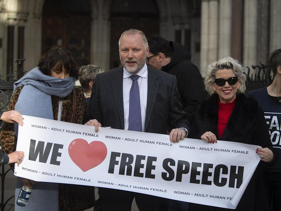 Harry Miller with supporters outside the High Court in London: PA