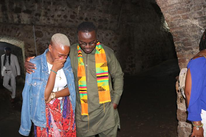 A tour guide comforts NAACP Youth and College Director Tiffany Dena Loftin iinside the Cape Coast Slave Castle on Ghana's coast. Africans captured by slave traders were herded inside small dungeons and endured horrendous conditions before being put on a ship to lands unknown. Those who died were thrown to the sharks; those who survived were sent across the sea in chains.