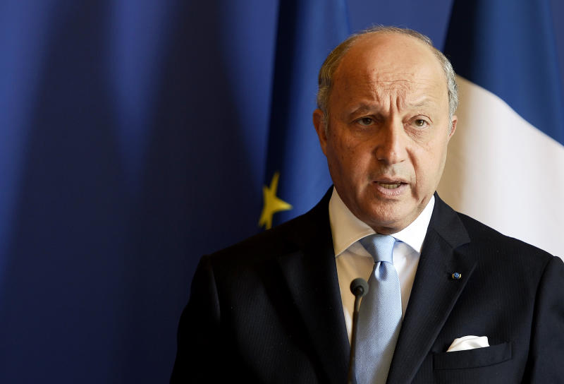 French Foreign Affairs minister Laurent Fabius delivers a press conference at the Quai d'Orsay on June 25, 2014 following the release of pictures by ECPAD showing the crash site of the Air Algerie flight AH5017 in Mali's Gossi region, west of Gao