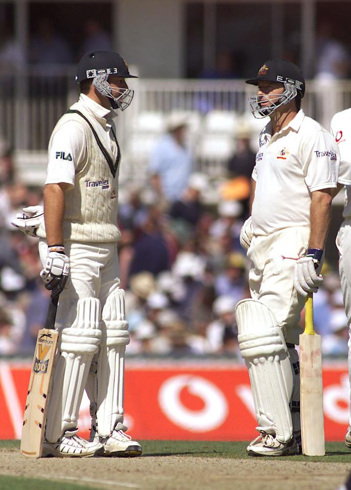 24 Aug 2001:  Mark and Steve Waugh of Australia chat between overs, during day two of the Fifth Test between England and Australia, at The Oval, London, England.  DIGITAL IMAGE Mandatory Credit: Hamish Blair/ALLSPORT