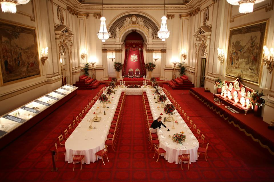 LONDON, ENGLAND - JULY 23: Table settings are laid out in the Palace Ballroom for a State Banquet at The Royal Welcome Summer opening exhibition at Buckingham Palace on July 23, 2015 in London, England. Last year the Royal Family welcomed around 62,000 guests to Buckingham Palace, at State Visits, receptions, Garden Parties, Investitures and private audiences. At the Summer Opening of the Palace, displays throughout the State Rooms have recreated the settings for some of these royal occasions, and give an insight into what goes into creating a royal welcome, from the laying of a table at a State Banquet, to the creation of an outfit worn by Her MajestyThe Queen to receive visitors.  (Photo by Peter Macdiarmid/Getty Images)