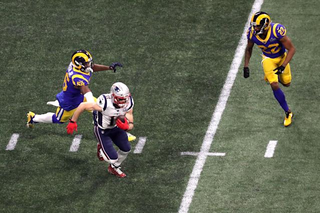 <p>Julian Edelman #11 of the New England Patriots runs the ball against Dante Fowler #56 and Marcus Peters #22 of the Los Angeles Rams in the third quarter performs during the Pepsi Super Bowl LIII Halftime Show at Mercedes-Benz Stadium on February 03, 2019 in Atlanta, Georgia. (Photo by Rob Carr/Getty Images) </p>