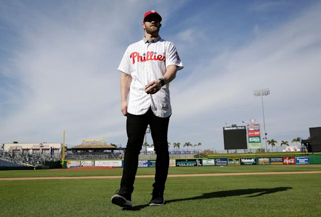 Bryce Harper walks on the field after being introduced during a news conference at the Philadelphia Phillies spring training baseball facility, Saturday, March 2, 2019, in Clearwater, Fla. Harper and the Phillies agreed to a $330 million, 13-year contract, the largest deal in baseball history. (AP Photo/Lynne Sladky)