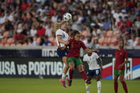 United States' Lindsey Horan (9) and Portugal's Andreia Norton (8) go up for a header during the first half of an international friendly soccer match Thursday, June 10, 2021, in Houston. (AP Photo/David J. Phillip)