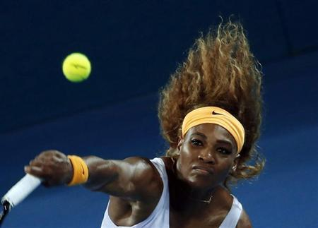 Serena Williams of the U.S. serves to Victoria Azarenka of Belarus during their women's final match at Brisbane International tennis tournament