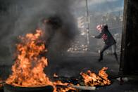 <p>Palestinian youth throws rocks at Israeli Defence Forces in the streets on December 11, 2017 in North of Ramallah, West-Bank. Protest continues into the sixth day in an already divided city, U.S. President Donald Trump pushed relations in the city to breaking point after making the announcement to recognize Jerusalem as Israel's capital. (Ilia Yefimovich/Getty Images) </p>