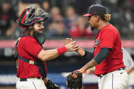 Cleveland Indians relief pitcher Emmanuel Clase, right, and catcher Austin Hedges celebrate after the Indians defeated the Kansas City Royals 4-1 in a baseball game, Tuesday, Sept. 21, 2021, in Cleveland. (AP Photo/Tony Dejak)