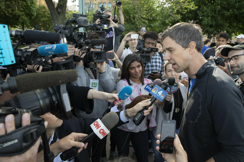 Democratic presidential candidate Beto O'Rourke talks to the media after participating in a 2-mile run with members and friends of the LGBTQ community, Wednesday, June 12, 2019 in New York. (AP Photo/Mark Lennihan)