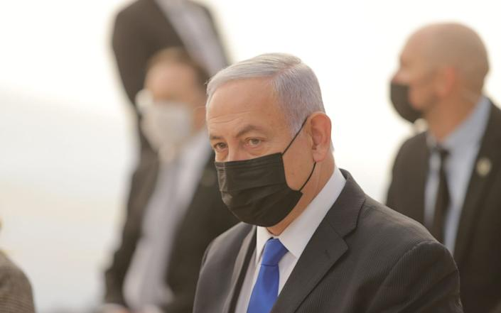 Israeli Prime Minister Benjamin Netanyahu, mask-clad due to the COVID-19 coronavirus pandemic, attends the opening ceremony for Sha'ar Hagay national site - Alex Kolomiensky/Pool/AFP