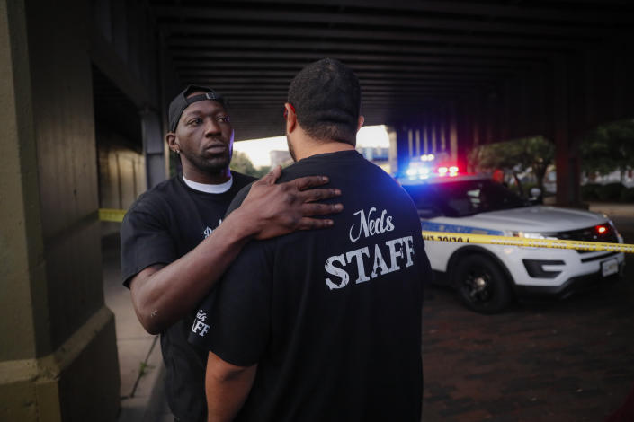 Witnesses comfort one another at the scene of a mass shooting, Sunday, Aug. 4, 2019, in Dayton, Ohio. Several people in Ohio have been killed in the second mass shooting in the U.S. in less than 24 hours, and the suspected shooter is also deceased, police said. (Photo: John Minchillo/AP)