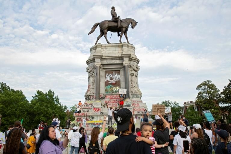 A statue of Confederate General Robert E. Lee has become a target of racial justice protesters following the death of George Floyd (AFP Photo/Ryan M. Kelly)