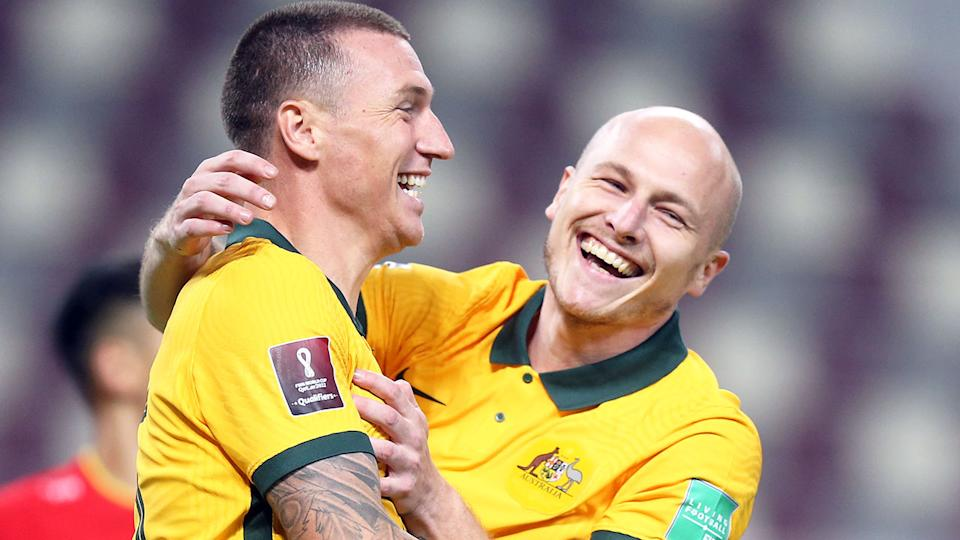 Seen here, Socceroos stars Mitch Duke and Aaron Mooy celebrate a goal for Australia.