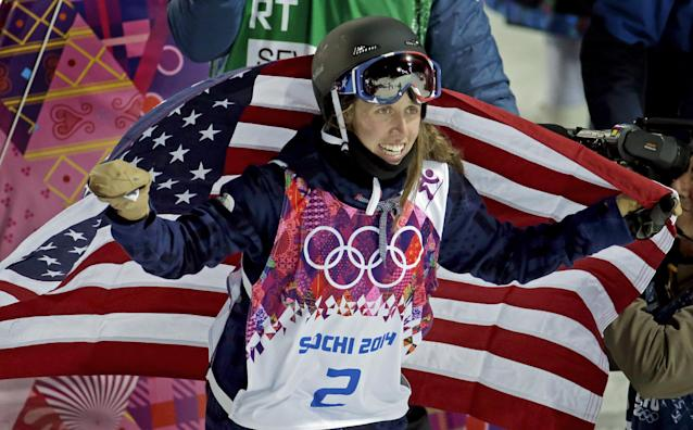 Maddie Bowman of the United States celebrates her gold medal in the women's ski halfpipe at the Rosa Khutor Extreme Park, at the 2014 Winter Olympics, Thursday, Feb. 20, 2014, in Krasnaya Polyana, Russia. (AP Photo/Charlie Riedel)
