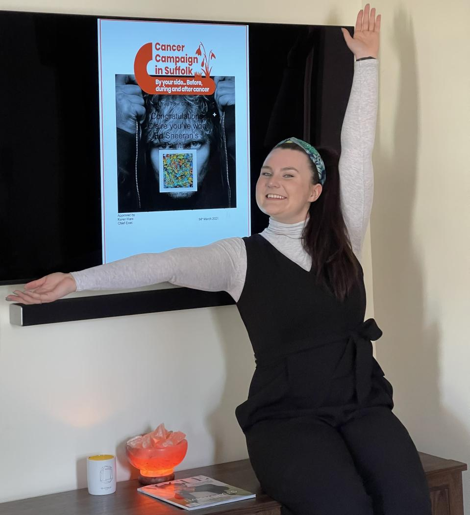 Claire Faynor, 22, of Vermont, won a painting by pop star Ed Sheeran after buying a £20 raffle ticket (Claire Faynor/ PA)