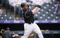 Colorado Rockies' C.J. Cron watches his grand slam off Milwaukee Brewers starting pitcher Brandon Woodruff during the first inning of a baseball game Thursday, June 17, 2021, in Denver. (AP Photo/David Zalubowski)