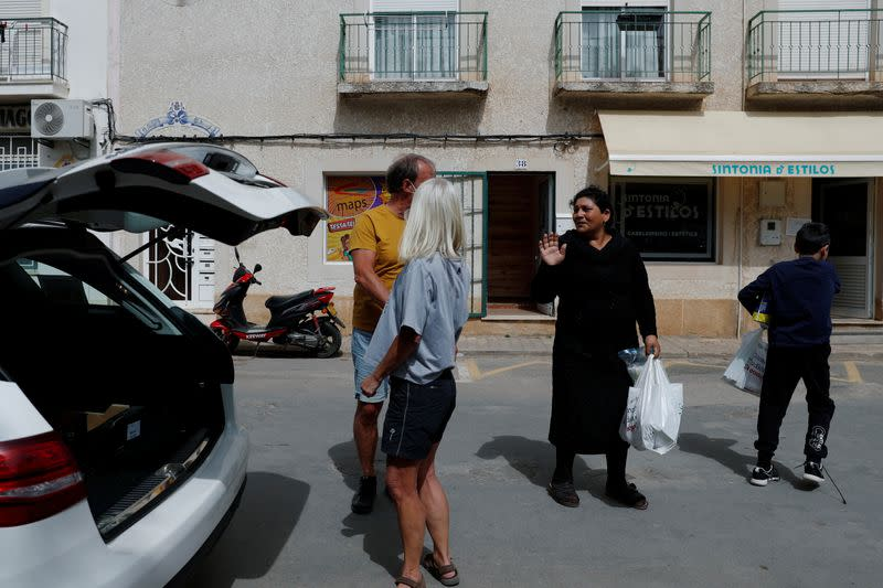 A woman thanks the volunteers of East Algarve Families in Need Food Bank after collecting food, during the coronavirus disease (COVID-19) pandemic in Tavira