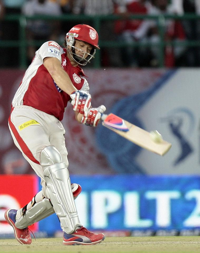 Kings XI Punjabs  Captain Adam Gilchirst plays a shot  during the IPL Twenty20 cricket match between Kings XI Punjab and Chennai Super King  at Himachal Pradesh Cricket stadium in Dharamsala  on May 17, 2012.  Kings XI Punjab win by 6 wickets.  RESTRICTED TO EDITORIAL USE. MOBILE USE WITHIN NEWS PACKAGE. AFP PHOTO/RAVEENDRAN        (Photo credit should read RAVEENDRAN/AFP/GettyImages)
