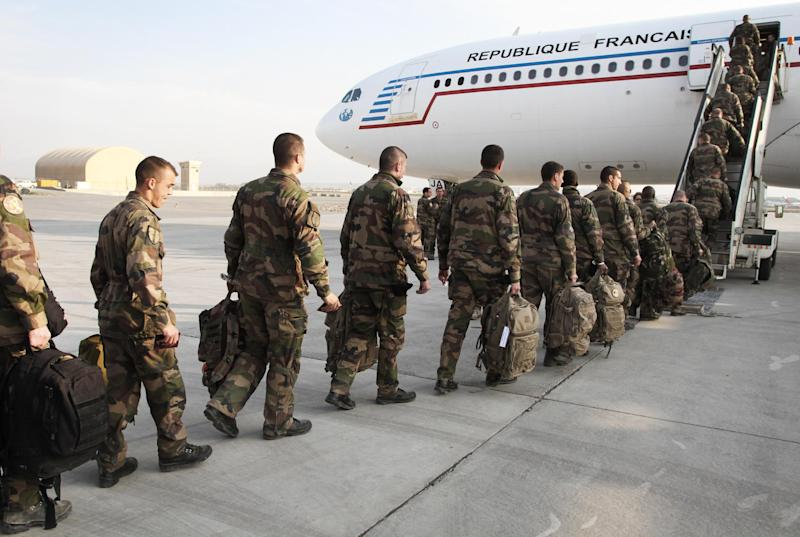 French soldiers, part of the NATO- led International Security Assistance Force (ISAF) prepare for departure at the Afghanistan airport in Kabul, Wednesday, March 28, 2012.  Some 200 French troops left Afghanistan on Wednesday, the group of soldiers are part of 1000 French troops set to leave the country this year. (AP Photo/Musadeq Sadeq)