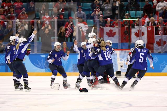 <p>The United States celebrates after defeating Canada in a shootout to win the Women's Gold Medal Game on day thirteen of the PyeongChang 2018 Winter Olympic Games at Gangneung Hockey Centre on February 22, 2018 in Gangneung, South Korea. (Photo by Jamie Squire/Getty Images) </p>