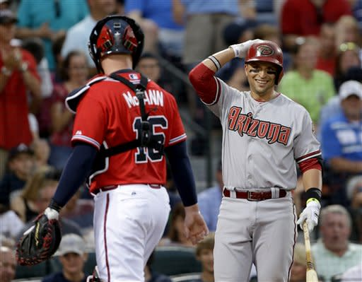 Arizona Diamondbacks' Martin Prado, right, steps to bat as he returns to Atlanta for the first time since being traded from the Atlanta Braves to the Diamondbacks, as Braves catcher Brian McCann looks on during the second inning of a baseball game, Friday, June 28, 2013, in Atlanta. (AP Photo/David Goldman)