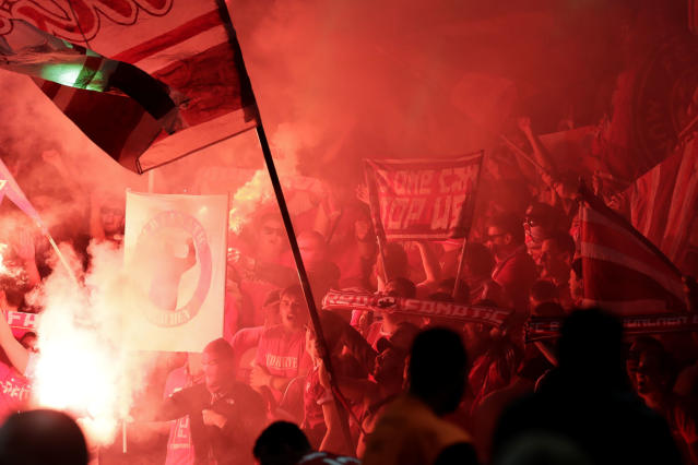 Bayern supporters light flares and cheer their team during the German soccer cup final match between FC Bayern Munich and Eintracht Frankfurt in Berlin, Germany, Saturday, May 19, 2018. (AP Photo/Michael Sohn)