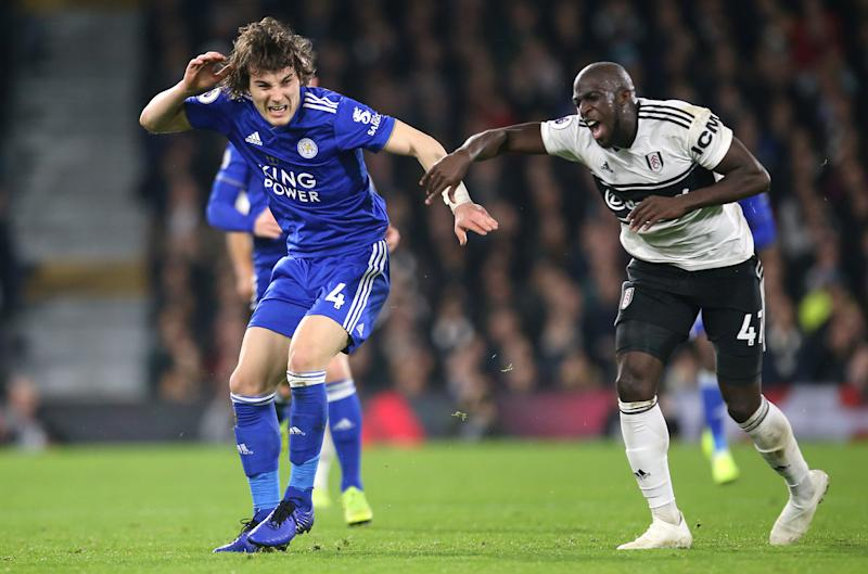 Leicester City's Caglar Soyuncu (left) and Fulham's Aboubakar Kamara battle for the ball during the Premier League match at Craven Cottage, London. (Photo by Steven Paston/PA Images via Getty Images)