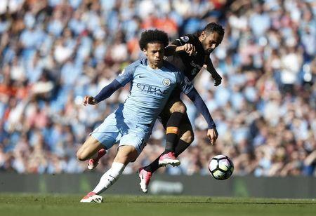 Manchester City's Leroy Sane in action with Hull City's Ahmed Elmohamady