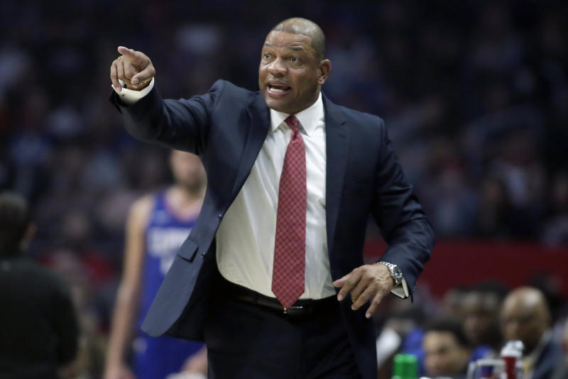 Los Angeles Clippers head coach Doc Rivers talks to his players during the first half of an NBA basketball game against the Minnesota Timberwolves in Los Angeles, Saturday, Feb. 1, 2020. (AP Photo/Alex Gallardo)