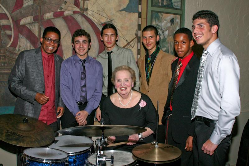In this 2011 photo provided by The Monk Institute, former U.S. Secretary of State Madeleine Albright, center, poses for a photo with Herbie Hancock, far left, and New World School of the Arts students at Miami Dade College in Miami, Fla.  Albreight, America's first female secretary of state, is game to give it another go on drums on Sept. 23, 2012, when she returns to the Kennedy Center to receive a Thelonious Monk Institute of Jazz award in honor of her longtime support for jazz, music education and the institute's programs.  (AP Photo/The Monk Institute, Phil Roche)