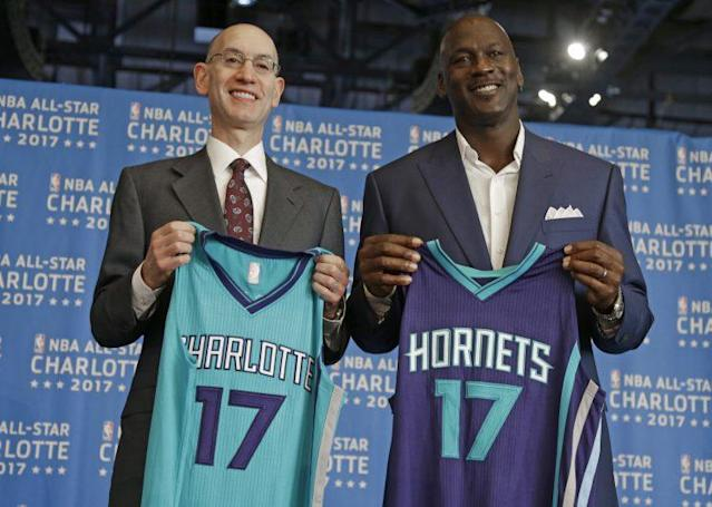 """NBA Commissioner Adam Silver (left) and <a class=""""link rapid-noclick-resp"""" href=""""/nba/teams/cha/"""" data-ylk=""""slk:Charlotte Hornets"""">Charlotte Hornets</a> owner <a class=""""link rapid-noclick-resp"""" href=""""/ncaaf/players/263612/"""" data-ylk=""""slk:Michael Jordan"""">Michael Jordan</a> pose for a photo during a June 23, 2015, news conference to announce Charlotte, N.C., as the site of the 2017 NBA All-Star Game. (AP/Chuck Burton"""