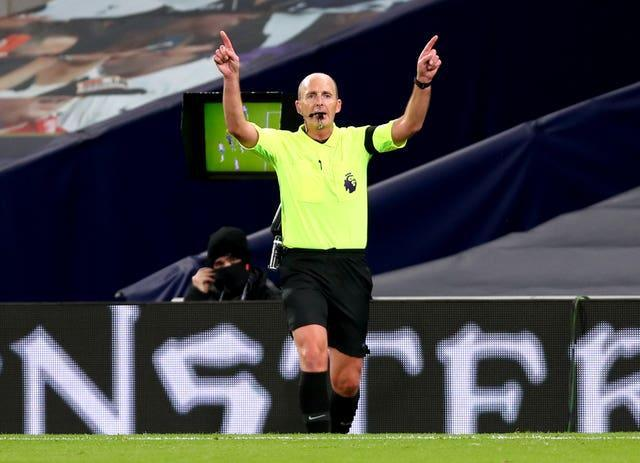 Referee Mike Dean disallows a goal scored by Aymeric Laporte during Manchester City's 2-0 loss at Tottenham in November having consulted a pitchside monitor. VAR remained a hot topic throughout the season, often adding to controversy rather than eradicating it