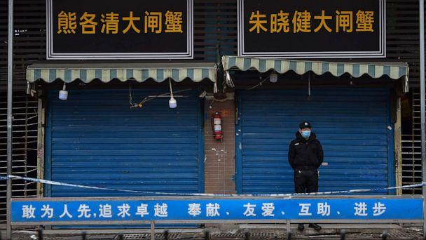 PHOTO: A security guard stands outside the Huanan Seafood Wholesale Market where the coronavirus was detected in Wuhan, China, on Jan. 24, 2020. (Hector Retamal/AFP via Getty Images, FILE)