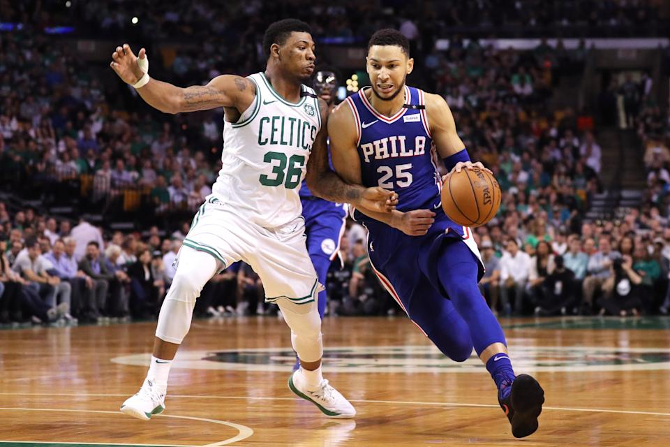 Ben Simmons tries to find some room to work against the Celtics' Marcus Smart on Thursday night. (Getty Images)