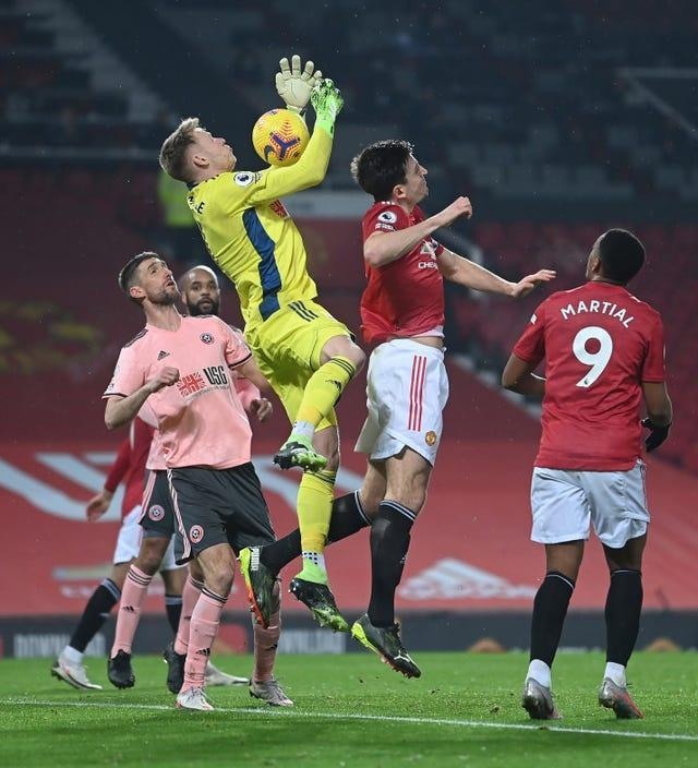 Harry Maguire was adjudged to have fouled Sheffield United goalkeeper Aaron Ramsdale before Anthony Martial found the net