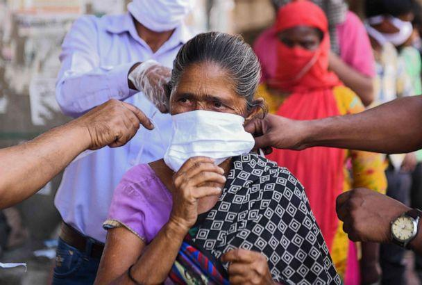 PHOTO: Volunteers of the Diocese of Amritsar Church of North India distribute face masks to people during a government-imposed nationwide lockdown as a preventive measure against the COVID-19 coronavirus, in Amritsar, April 15, 2020. (Narinder Nanu/AFP/Getty Images)