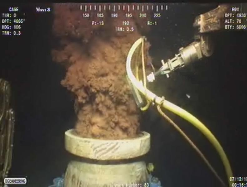 FILE - In this Monday July 12, 2010 image from video made available by BP PLC, oil flows out of the top of the transition spool, which was placed into the gushing wellhead and will house the new containment cap, at the site of the Deepwater Horizon oil spill in the Gulf of Mexico. The federal trial over the 2010 BP oil spill resumed Monday, Sept. 30, 2013, with a focus on the company's response to the disaster, with millions of dollars at stake as the two sides argue over how much oil spewed into the Gulf of Mexico. (AP Photo/BP PLC, File)