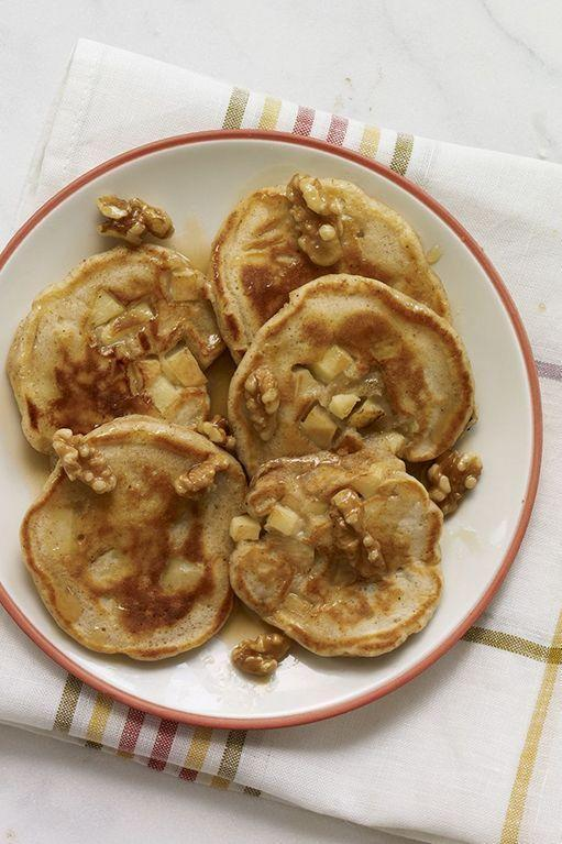 """<p>Take your pancakes to the next level with these apple-maple flapjacks. </p><p><strong><em><a href=""""https://www.womansday.com/food-recipes/food-drinks/recipes/a12264/apple-pie-pancakes-maple-walnuts-recipe-wdy0113/"""" rel=""""nofollow noopener"""" target=""""_blank"""" data-ylk=""""slk:Get the Apple Pie Pancakes with Maple Walnuts recipe."""" class=""""link rapid-noclick-resp"""">Get the Apple Pie Pancakes with Maple Walnuts recipe.</a> </em></strong></p>"""