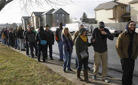File of people waiting in line to be among the first to legally buy recreational marijuana at the Botana Care store in Northglenn