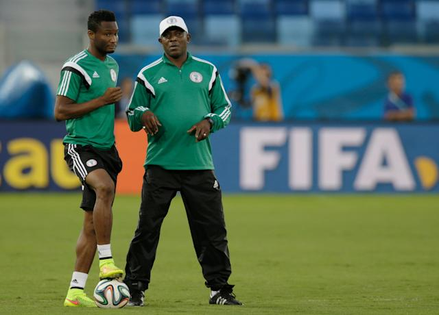 Nigeria coach Stephen Keshi, right, speaks with his player Mikel John Obi during a training session at the Arena Pantanal in Cuiaba, Brazil, Friday, June 20, 2014. Nigeria plays in group F of the 2014 soccer World Cup. (AP Photo/Fernando Llano)