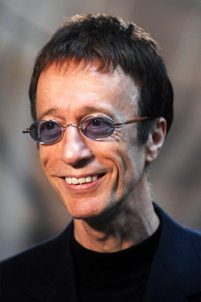 FILE  This Wednesday April 11, 2007 file photo shows Bee Gees singer Robin Gibb as he talks with journalists at the European Parliament in Brussels. British media reports said Saturday April 14, 2012 former Bee Gee Robin Gibb is gravely ill with pneumonia in a London hospital. The Sun newspaper reported Saturday that 62-year-old Gibb is in a coma, citing a family friend.  (AP Photo/Geert Vanden Wijngaert)