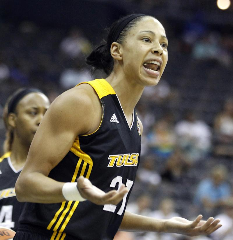 File- This July 17, 2011 file photo shows Tulsa Shock forward Jennifer Lacy reacting after being called for a foul against the New York Liberty during the first quarter of a WNBA basketball game, Sunday, in Newark, N.J.  Atlanta police say a warrant has been issued for former WNBA star and Olympic gold medalist Chamique Holdsclaw who is accused of shooting into a woman's car after using a bat to break its windows.  Police said Thursday that Holdsclaw followed the woman, Lacy, to her car on Tuesday Nov. 13, 2012. WNBA spokesman Ron Howard says the 29-year-old Lacy plays for the Tulsa Shock.   (AP Photo/Julio Cortez,File)